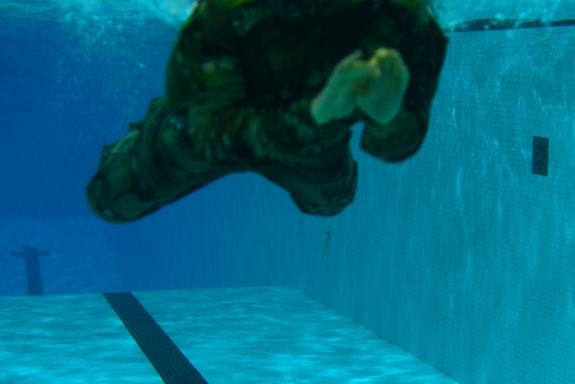 An U.S. Army Soldier dives into a pool for the 100-meter swim during the German Armed Forces Badge for military Proficiency event at Joint Base Langley-Eustis, Va., Nov. 2, 2016.  The 100-meter swim in uniform is one of six GAFPB events and must be completed within four minutes. (U.S. Air Force photo/Tech Sgt. Daylena S. Ricks)