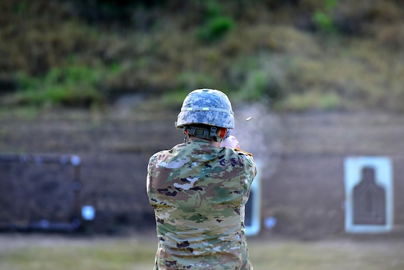 An U.S. Army Soldier fires a 9 mm Beretta automatic pistol in the standing unsupported position during the German Armed Forces Badge for military Proficiency event at Joint Base Langley-Eustis, Va., Nov. 4, 2016. The pistol exercise is one of six GAFPB events, members fire two bullets performing three different shooting positions, aiming to hit the target. (U.S. Air Force photo/Tech Sgt. Daylena S. Ricks)