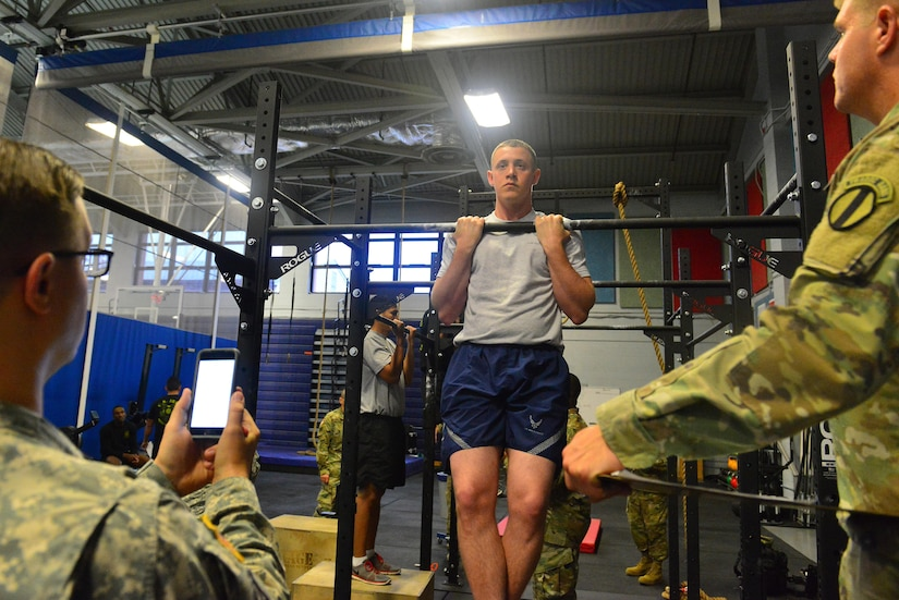 U.S. Air Force Airman 1st Class Derek Siefert, 633rd Air Base Wing, Public Affairs photojournalist performs a flexed-arm hang during the German Armed Forces Badge for military Proficiency at Joint Base Langley-Eustis, Va., Nov. 1, 2016.  The GAFPB flexed-arm hang is just one of three events that make up the basic fitness test; five second hold is the minimum requirement to pass.  The other two events are: 11 by 10-meter sprint test finishing within 60 seconds and a 1,000 meter run finishing within six minutes and 30 seconds.  (U.S. Air Force photo/Tech Sgt. Daylena S. Ricks)