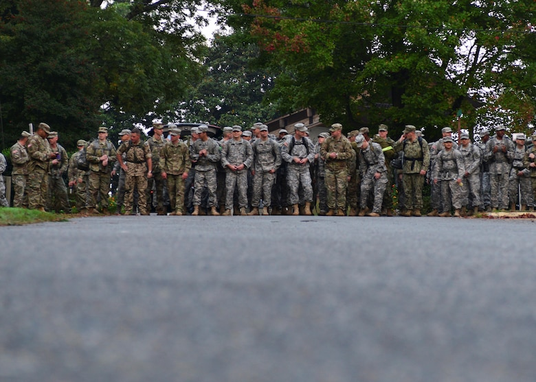 U.S. Air Force Airmen, U.S. Army Soldiers, U.S. Navy Sailors put on their rucks for the road march during the German Armed Forces Badge for military Proficiency event at Joint Base Langley-Eustis, Va., Nov. 3, 2016.  The GAFPB road march is based on completion time and distance.  To earn gold in this event the member must march 12 kilometers within 120 minutes, silver, nine kilometer within 90 minutes, bronze, six kilometers within 60 minutes. (U.S. Air Force photo/Tech. Sgt. Katherine Ward)