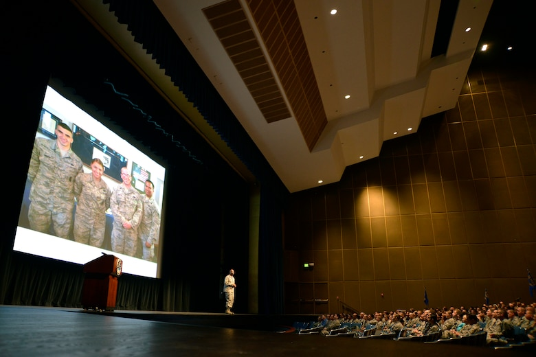 Col. Troy Dunn, commander of the 10th Air Base Wing, speaks from the stage in Arnold Hall Nov. 4, 2016 at the U.S. Air Force Academy. Dunn hosted an all call to thank the Total Force Airmen assigned to the wing for their daily efforts and discuss his priorities as the commander. (U.S. Air Force photo/Jason Gutierrez)