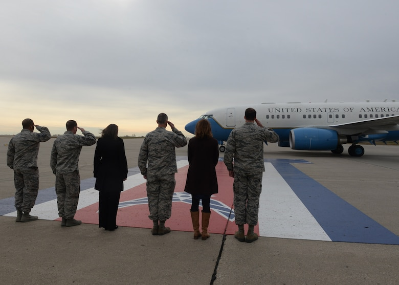 Base leadership stands with their spouses as they salute U.S. Marine Corps Gen. Joseph F. Dunford Jr., chairman of the Joint Chiefs of Staff, as he lands at Minot Air Force Base, N.D., Nov. 2, 2016. Dunford visited Airmen and spoke about the importance of maintaining a competitive advantage over our adversaries.  (U.S. Air Force photos/Airman 1st Class Jessica Weissman)