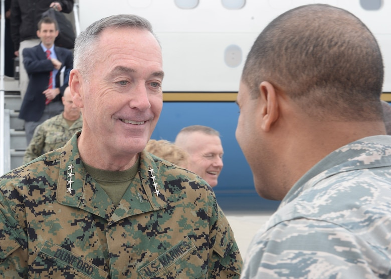 U.S. Marine Corps Gen. Joseph F. Dunford Jr., chairman of the Joint Chiefs of Staff, is greeted by Chief Master Sgt. John Burks, 91st Missile Wing command chief, at Minot Air Force Base, N.D., Nov. 2, 2016. Dunford toured various 5th Bomb Wing and the 91st MW's facilities to learn about their mission and capabilities. (U.S. Air Force photos/Airman 1st Class Jessica Weissman)