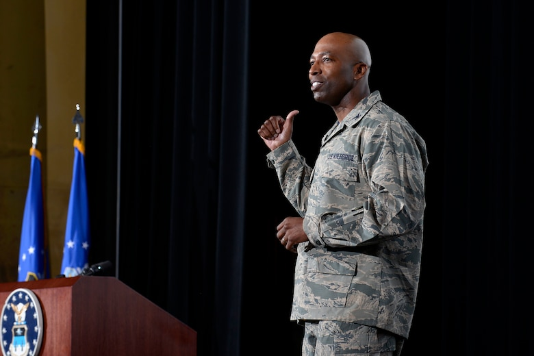 Col. Troy Dunn. commander of the 10th Air Base Wing at the U.S. Air Force Academy, speaks from the stage in Arnold Hall Nov. 4, 2016. Dunn hosted an all call to to discuss his priorities as commander, thank his team of Total Force Airmen, and advocate for the care and concern of Airmen at the wing. (U.S. Air Force photo/Jason Gutierrez)
