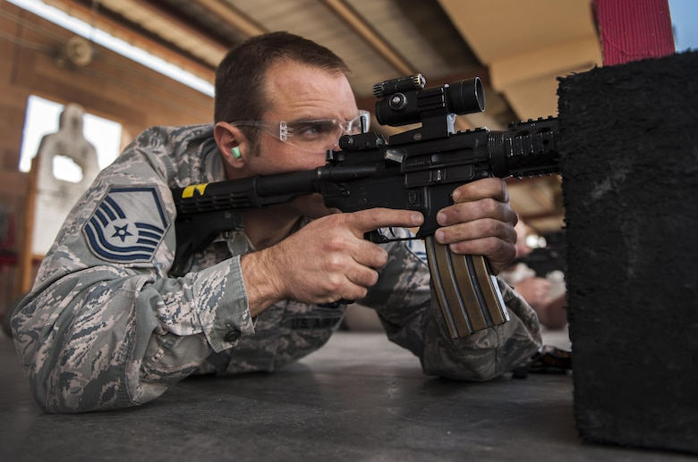 Master Sgt. Dennis Hutchinson, 57th Maintenance Group, fires an M4 carbine during a Combat Arms Training and Maintenance class on Nellis Air Force Base, Nev., Oct. 25, 2016. CATM classes are most associated with the opportunity to go the range and enhance skills with a weapon. (U.S. Air Force photo by Airman 1st Class Kevin Tanenbaum/Released)