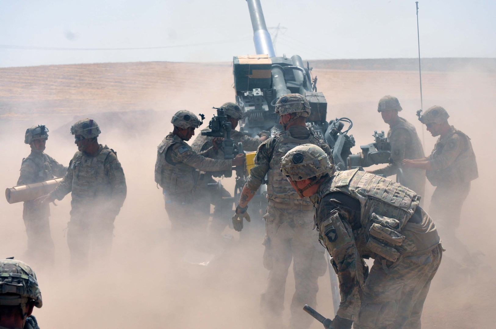 In this file photo taken Aug. 15, 2016, U.S Army Soldiers, Battery C, 1st Battalion, 320th Field Artillery Regiment, Task Force Strike, begin their crew drill to load another round for a fire mission in northern Iraq. The 526th Brigade Support Battalion's Support Operations Cell and the 336th Combat Support Sustainment battalion's movement control team in Erbil have sustained operations like this one which are critical to defeat the Islamic State of Iraq and the Levant. (U.S. Army photo by 1st Lt. Daniel I Johnson)