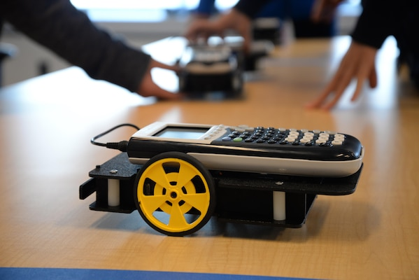 A calculator-controlled robot waits to race with other robots, which were programmed by 10th-graders from Wootton High School's Academy of Information Technology during a science, technology, engineering and math (STEM) event at Naval Surface Warfare Center, Carderock Division Nov. 2, 2016 in West Bethesda, Md. U.S. Navy photo by Kelley Stirling (Released)