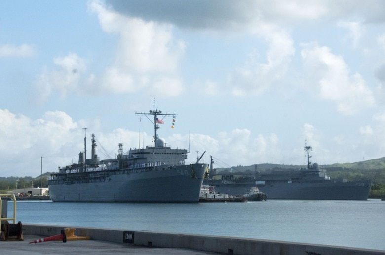 Submarine tender USS Frank Cable (AS 40) passes the U.S. Navy's only other submarine tender, USS Emory S. Land (AS 39), in Apra Harbor following Frank Cable's return to home port this morning after completing a five-month deployment, Nov, 8, 2016. Frank Cable departed Guam June 6 and was a persistent presence throughout the Indo-Asia-Pacific region during its deployment, providing vital flexibility to the fleet commanders and extending the range and impact of U.S. naval forces in the U.S. Navy's 5th and 7th Fleets. Forward deployed to Guam, Frank Cable's combined Navy and Military Sealift Command's crew's mission is to provide critical warfighting repairs, rearmament and reprovisioning to deployed naval forces of the United States.
