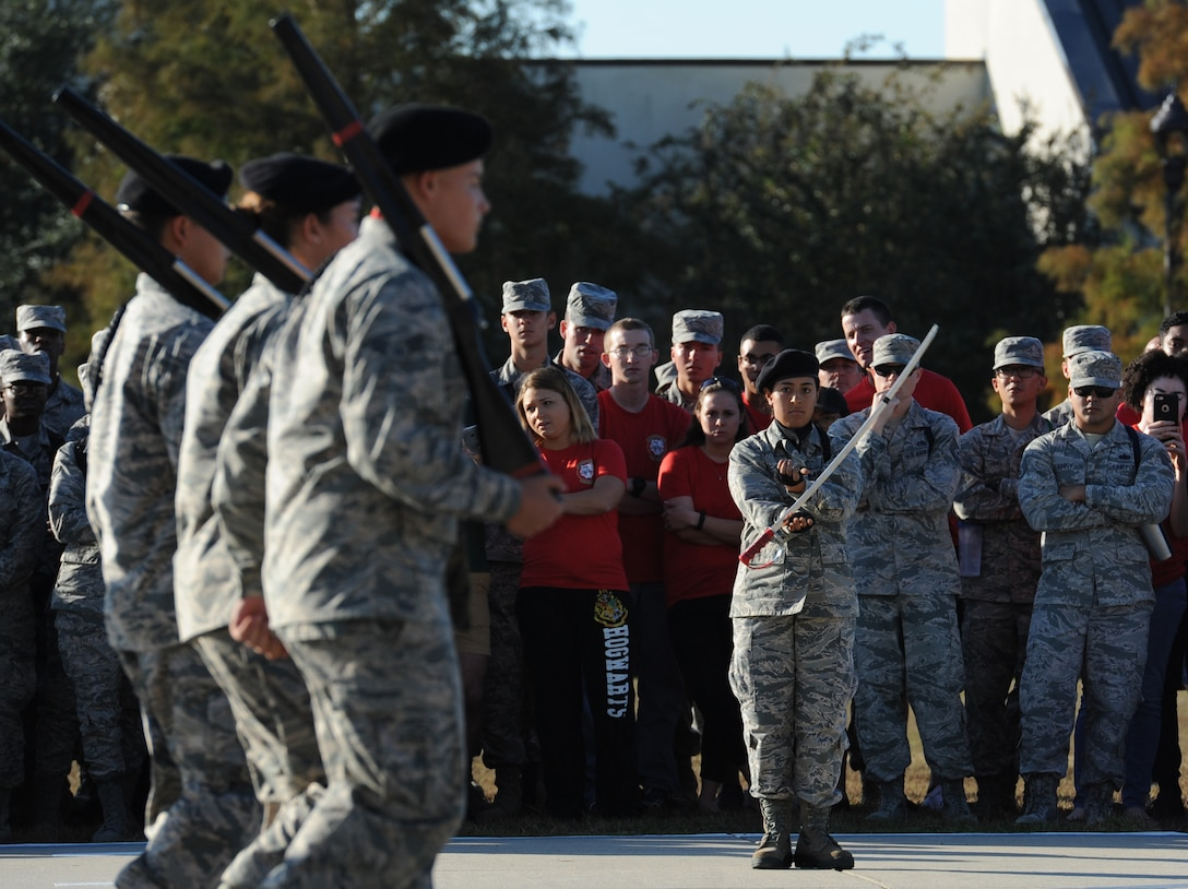 "Airman Basic Sierra Guitron, 336th Training Squadron freestyle drill team member, spins a sword during the 81st Training Group drill down at the Levitow Training Support Facility drill pad Nov. 4, 2016, on Keesler Air Force Base, Miss. The quarterly drill down featured an open ranks inspection, regulation drill routine and freestyle drill routine categories. The 81st TRG's four non-prior service training squadrons competed in the competition, with the 334th TRS ""Gators"" taking home the overall first place. (U.S. Air Force photo by Kemberly Groue/Released)"