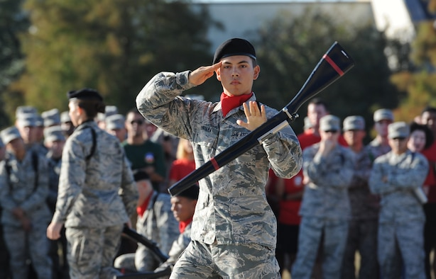 "Airman Basic Clayton Quintana, 336th Training Squadron freestyle drill team member, spins a rifle during the 81st Training Group drill down at the Levitow Training Support Facility drill pad Nov. 4, 2016, on Keesler Air Force Base, Miss. The quarterly drill down featured an open ranks inspection, regulation drill routine and freestyle drill routine categories. The 81st TRG's four non-prior service training squadrons competed in the competition, with the 334th TRS ""Gators"" taking home the overall first place. (U.S. Air Force photo by Kemberly Groue/Released)"