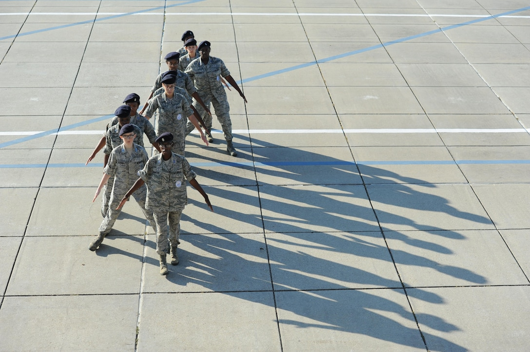 """Members of the Biloxi High School JROTC drill team provide a guest performance during the 81st Training Group drill down at the Levitow Training Support Facility drill pad Nov. 4, 2016, on Keesler Air Force Base, Miss. The quarterly drill down featured an open ranks inspection, regulation drill routine and freestyle drill routine categories. The 81st TRG's four non-prior service training squadrons competed in the competition, with the 334th TRS """"Gators"""" taking home the overall first place. (U.S. Air Force photo by Kemberly Groue/Released)"""