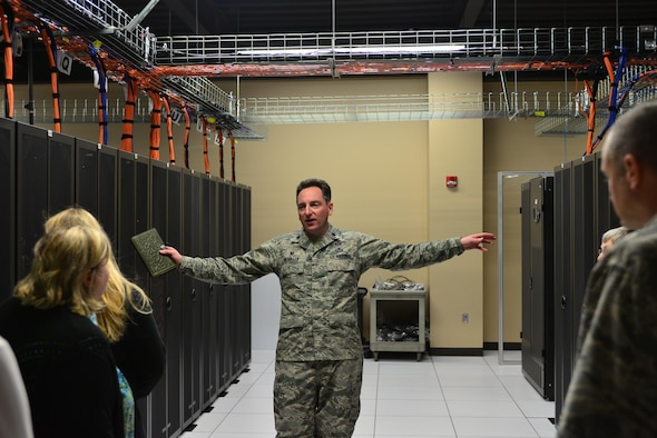 Lt. Col. John McMillen, commander of the 2nd Systems Operations Squadron, gives a tour of the  High-Performance Computing Center in the 557th Weather Wing at Offutt Air Force Base, Neb., to spouses and service members during the Spouses Town Hall Nov. 1, 2016. The town hall, which included briefings on the Key Spouses program, a meet and greet with wing leadership and a tour of the 557th WW facilities, gave spouses a greater understanding of the 557th WW mission. (U.S. Air Force photo/Senior Airman Rachel Hammes)