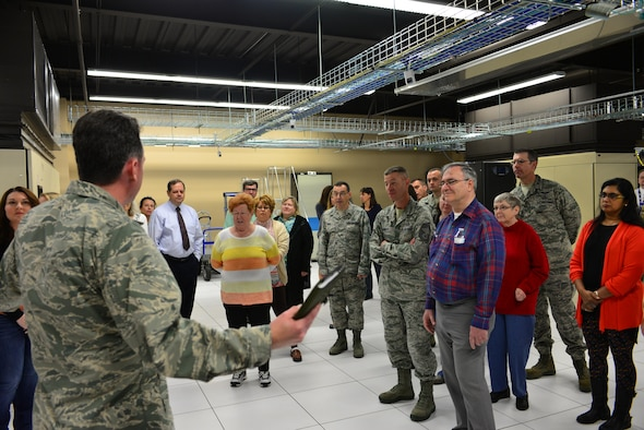 Service members and spouses take a tour of the High-Performance Computing Center in the 557th Weather Wing at Offutt Air Force Base, Neb., during the Spouses Town Hall Nov. 1, 2016. The town hall, which included briefings on the Key Spouses program, a meet and greet with wing leadership and a tour of the 557th WW facilities, gave spouses a greater understanding of the 557th WW mission. (U.S. Air Force photo/Senior Airman Rachel Hammes)