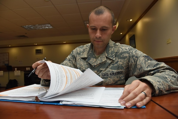 Staff Sgt. Garrett Klever, 335th Training Squadron student, reviews personnel apprentice course study material at Wolfe Hall Nov. 8, 2016, on Keesler Air Force Base, Miss. Klever graduated with perfect scores throughout the course. After graduation he will return to the 142nd Force Support Squadron, Portland Air National Guard Base, Ore. (U.S. Air Force photo by Kemberly Groue/Released)