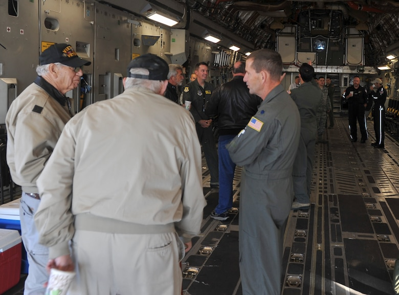 U.S. Air force and local civilian pilots gather for Joint Base Charleston's first Mid-Air Collision Avoidance event in the back of a C-17 Globemaster III Nov. 5, 2016. The MACA program is designed to promote aviation safety between military and civilian pilots who share the local airspace. Sharing the mission of JB Charleston with community civilian pilots offers a better understanding of why specific procedures are put in place. The event gives pilots, military and civilian, a forum to discuss flying and aviation safety.