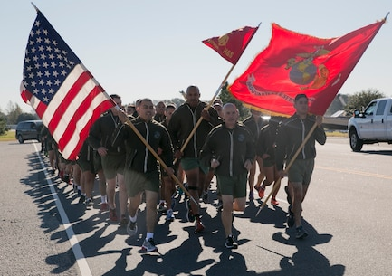 Col. Charles Dunne, commanding officer, Headquarters and Service Battalion, U.S. Marine Corps Forces Command, leads MARFORCOM Marines, sailors and civilians during a three-mile run in honor of the Marine Corps' 241st birthday on Nov. 8, aboard Naval Station Norfolk. Marines yelled cadence throughout the run along the station's pier and received a t-shirt and refreshments after the run. (Official U.S. Marine Corps photo by Sgt. Kayla D. Rivera/ Released)