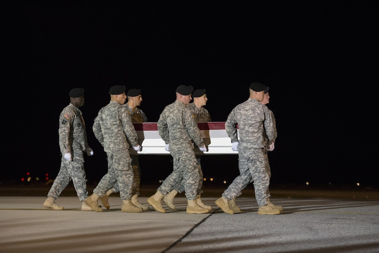 A U.S. Army carry team transfers the remains of U.S. Army Staff Sgt. Kevin J. McEnroe, 30, of Tucson, Ariz., Nov. 7, 2016, at Dover Air Force Base, Del. McEnroe was assigned to the 5th Special Forces Group (Airborne), Fort Campbell, Ky. (U.S. Air Force Photo by Senior Airman Aaron J. Jenne)