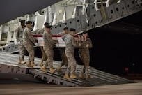 A U.S. Army carry team transfers the remains of U.S. Army Sgt. 1st Class Matthew C. Lewellen, 27, of Lawrence, Kan., Nov. 7, 2016, at Dover Air Force Base, Del. Lewellen was assigned to the 5th Special Forces Group (Airborne), Fort Campbell, Ky. (U.S. Air Force Photo by Senior Airman Aaron J. Jenne)