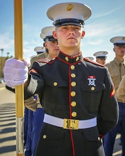 "Before Lance Cpl. Tristan Downing from Spokane, WA began serving as a Marine Corps cyber network operator in North Carolina, he graduated as the top Marine, aka ""guide,"" of his platoon on MCRD San Diego. Give him one! (U.S. Marine Corps photo by Cpl. Angelica Annastas)"