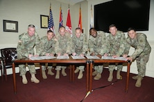 Maj. Gen. Wehr pulled his commanders and senior leaders together for the regional summit meeting (R5) in Vicksburg in November to foster ways to work more effectively as a regional team to solve difficult challenges. The leaders developed a list of focus areas for FY 17 which include the following: Strengthen the Foundation (Doing the routine things to an exceptionally high standard, routinely.) Deliver the Program (The most strategic thing we can do is deliver our mission…keep our promises.) Achieve our Vision (Leading ourselves into an unknowable future…together.  Our compelling, better tomorrow.) Pictured left to right are: Col. Mike Clancy, Col. Mike Derosier, Col. Mike Ellicott, Maj. Gen. Mike Wehr, Col. Anthony Mitchell, Col. Craig Baumgartner and Col. Sam. Calkins signing the FY17 Regional Focus poster.