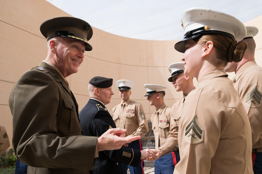 Marine Corps Gen. Joe Dunford, chairman of the Joint Chiefs of Staff, talks with Marine Corps security guards at the U.S. Embassy in Riyadh, Saudi Arabia.