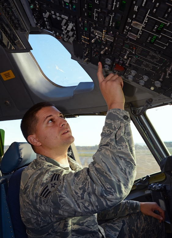 Senior Airman Jamal Agoun, 62nd Aircraft Maintenance Squadron instrument and flight control systems apprentice, troubleshoots the flight controls of a C-17 Globemaster III aircraft Nov. 3, 2016, at Joint Base Lewis-McChord, Wash. Agoun recently discovered a faulty C-17 heads up display assembly control panel saving the Air Force more than $390,000. (U.S. Air Force photo/Senior Airman Jacob Jimenez)