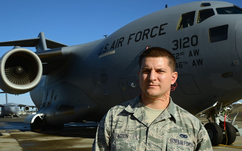 Senior Airman Jamal Agoun, 62nd Aircraft Maintenance Squadron instrument and flight control systems apprentice, poses in front of a C-17 Globemaster III aircraft Nov. 3, 2016, at Joint Base Lewis-McChord, Wash. Agoun was selected as the 62nd AMXS Spotlight for outstanding performance.(U.S. Air Force photo/Senior Airman Jacob Jimenez)