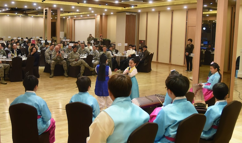 Students from Dangbook Elementary School perform a traditional Korean play during a volunteer appreciation night at the Hanwon Convention room in the city of Gunsan, Republic of Korea, Nov. 8, 2016. The students participated in an English language program taught by 8th Fighter Wing airmen. (U.S. Air Force photo by Tech. Sgt. Jeff Andrejcik/Released)