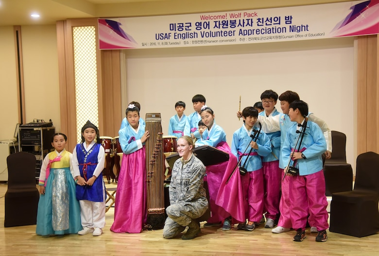 Staff Sgt. Robbin Toumberlin, 8th Operations Support Squadron noncommissioned officer in charge targets intelligence, is recognized with her students during an appreciation night at the Hanwon Convention room in the city of Gunsan, Republic of Korea, Nov. 8, 2016. Toumberlin taught English to local students in Gunsan City as a volunteer. (U.S. Air Force photo by Tech. Sgt. Jeff Andrejcik/Released)
