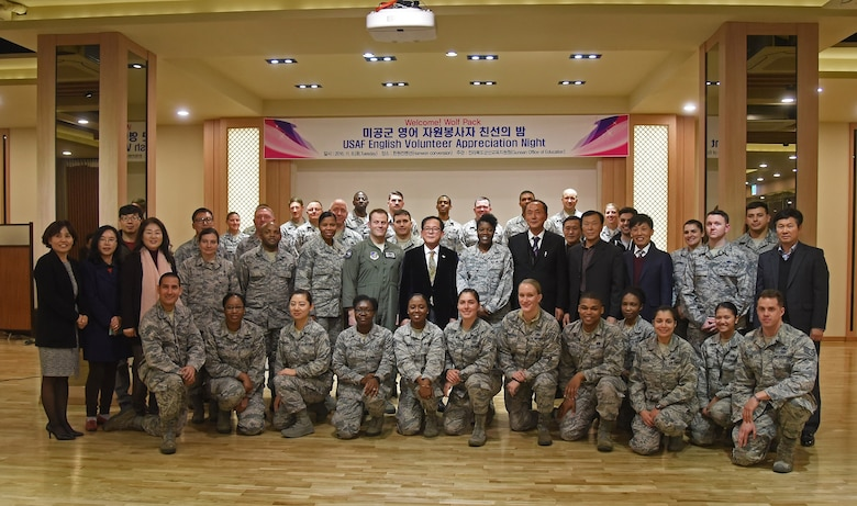 Airmen from the 8th Fighter Wing are recognized during a volunteer appreciation night at the Hanwon Convention room in the city of Gunsan, Republic of Korea, Nov. 8, 2016. Each of the volunteers taught English to students from 36 different schools in Gunsan. The students involved in the program also attended the appreciation night and were able to sit with their respective teachers. (U.S. Air Force photo by Tech. Sgt. Jeff Andrejcik/Released)