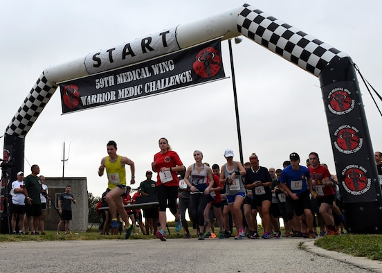 Runners kick off the Warrior Medic Challenge 9K run Nov. 4, 2016 at the Gillum Fitness Center and Sports Complex on Joint Base San Antonio-Lackland, Texas. The event also included a 5K and a fun run. (U.S. Air Force photo/Staff Sgt. Kevin Iinuma)