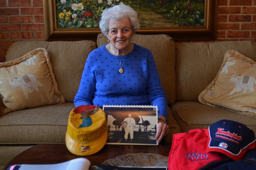 Barbara Ellis, wife of retired U.S. Air Force Maj. Gen. Billy Ellis, sits with some of her husband's memorabilia in Sumter, S.C., Nov. 7, 2016. Throughout the duration of his career, Billy Ellis served as an Air Demonstration Squadron Thunderbirds pilot as well as an SR-71 Blackbird pilot. (U.S. Air Force photo by Airman 1st Class Christopher Maldonado)