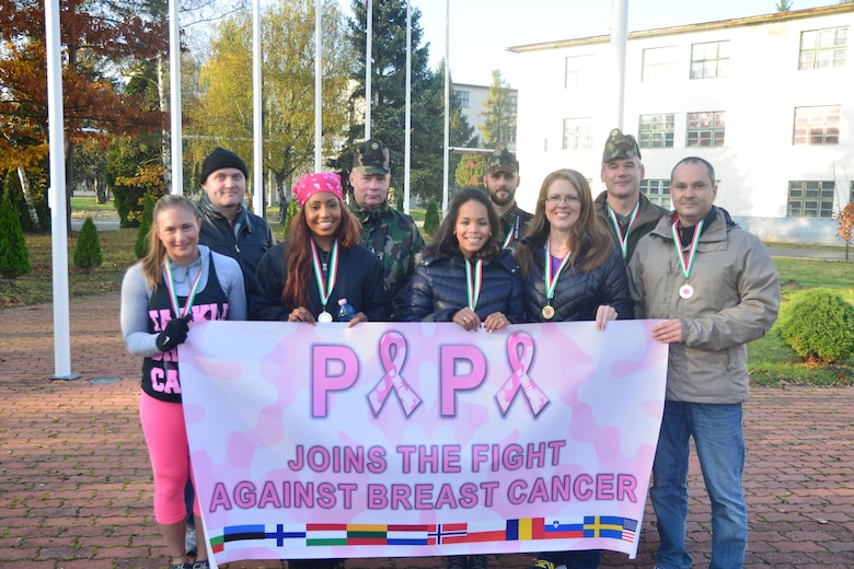 Volunteers from Team Aviano and the Heavy Airlift Wing participate in an annual Breast Cancer Awareness Walk at Papa Air Base, Hungary on Oct 28, 2016. More than 145 attendees from 12 countries participated in the event to support breast cancer awareness. (Courtesy photo)