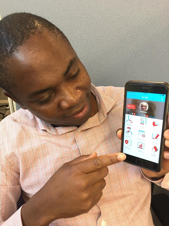 Senior Airman Jean Marc Tchazou, member of the 439th Force Support Squadron at Westover Air Reserve Base, Mass., shows members how to use e911md, a mobile application he created to help people connect with a doctor, but remain anonymous. (U.S. Air Force photo/ Capt. Meghan Smith)