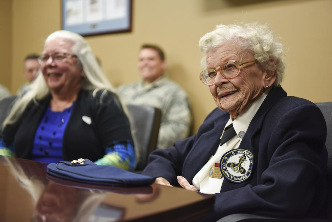 Ms. Jeanne Benedict, World War II cartographer, laughs as she shares her stories with the Airmen of the 497th Intelligence, Surveillance, and Reconnaissance Group during a tour at Joint Base Langley-Eustis Nov. 8, 2016. Ms. Benedict and her family was invited to visit the 36th Intelligence Squadron and 480th ISRW to pass on her experiences and knowledge as part of Veteran day. (U.S. Air Force photo by Tech. Sgt. Darnell T. Cannady)