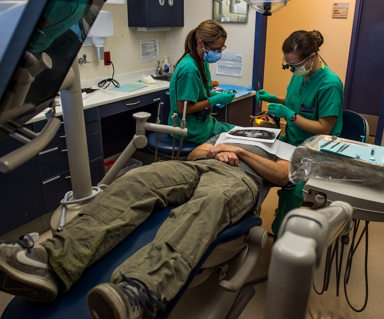 Capt. Rachael Sells and her dental assistant conduct an operation giving a patient braces, Scott Air Force Base, Ill., Oct. 25, 2016. Sells is one of four residents in the Advanced Education in General Dentistry Program.