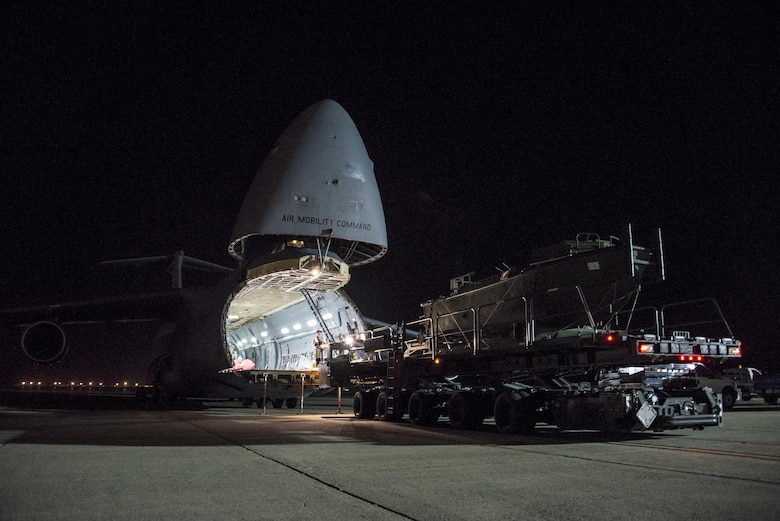 A U.S. Army Bridge Erection Boat (BEB) is uploaded onto a C-5M Super Galaxy May 7, 2016, at Travis Air Force Base, Calif. The 60th Aerial Port Squadron successfully uploaded multiple BEBs and bridges onto the aircraft in support of the counter-Islamic State of Iraq and the Levant campaign in Iraq as part of Operation Inherent Resolve. BEBs are used to deploy the bridges in wet-gap crossings. (U.S. Air Force photo by Staff Sgt. Charles Rivezzo)