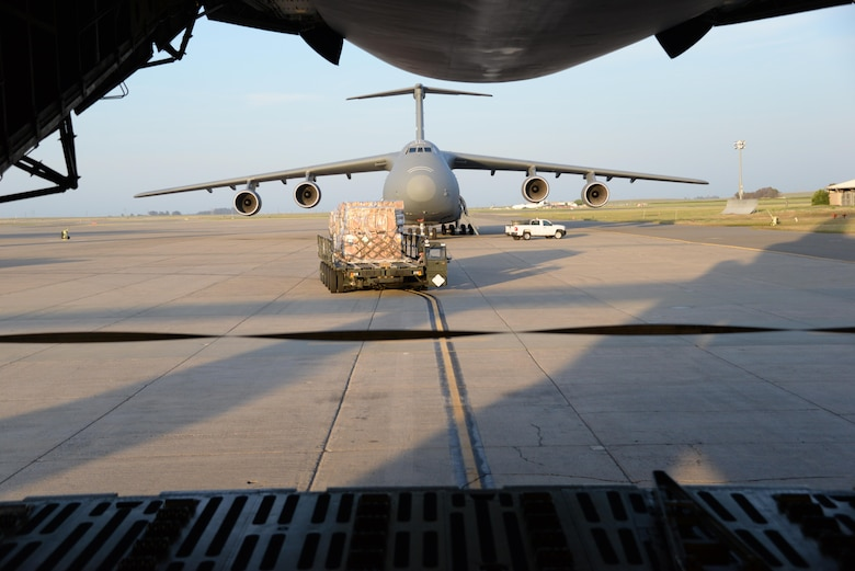 Airmen from the 60th Aerial Port Squadron load a C-5M Super Galaxy with essential cargo and U.S. Army Bridge Erection boats and bridges, May 12, 2016, at Travis Air Force Base, Calif. The bridges and cargo were flown to Iraq by the 22nd Airlift Squadron and directly contributed to the counter-Islamic State of Iraq and the Levant campaign during Operation Inherent Resolve in Mosul, Iraq. (U.S. Air Force photos by Senior Airman Amber Carter)