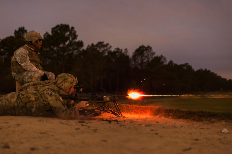 Sgt. 1st Class Joel Micholick, with the 9th Battalion, U.S. Army Careers Division, and the U.S. Army Reserve Combat Marksmanship Program, engages targets during a night fire event on the second day of the U.S. Army Forces Command Weapons Marksmanship Competition Nov. 8, 2016, at Fort Bragg, N.C. The four-day FORSCOM competition features marksmen from the U.S. Army, U.S. Army Reserve, and the National Guard in events for the M9 pistol, the M4A1 rifle and the M249 SAW, or Squad Automatic Weapon, to recognize Soldiers who are beyond expert marksmen. The multi-tiered events challenge the competitors' ability to accurately and quickly engage targets in a variety of conditions and environments. (U.S. Army photo by Timothy L. Hale/Released)