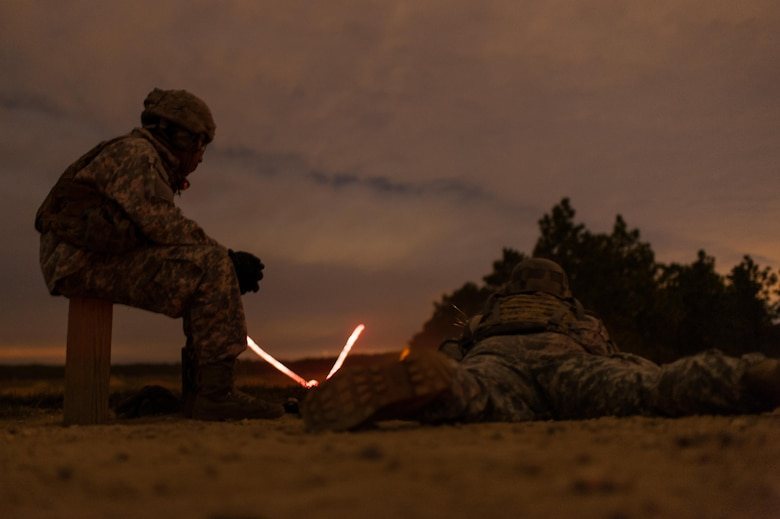 Tracer rounds fly down range as a competitor engages targets during a night fire event on the second day of the U.S. Army Forces Command Weapons Marksmanship Competition Nov. 8, 2016, at Fort Bragg, N.C. The four-day FORSCOM competition features marksmen from the U.S. Army, U.S. Army Reserve, and the National Guard in events for the M9 pistol, the M4A1 rifle and the M249 SAW, or Squad Automatic Weapon, to recognize Soldiers who are beyond expert marksmen. The multi-tiered events challenge the competitors' ability to accurately and quickly engage targets in a variety of conditions and environments. (U.S. Army photo by Timothy L. Hale/Released)