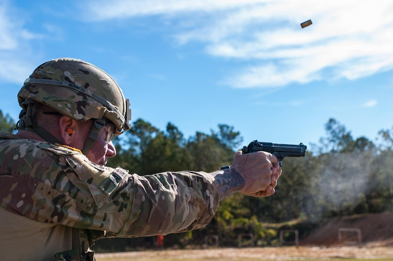 Master Sgt. Robert Mango, with the 9th Mission Support Command and the U.S. Army Reserve Combat Marksmanship Program, engages targets on the second day of the U.S. Army Forces Command Weapons Marksmanship Competition Nov. 8, 2016, at Fort Bragg, N.C. The four-day FORSCOM competition features marksmen from the U.S. Army, U.S. Army Reserve, and the National Guard in events for the M9 pistol, the M4A1 rifle and the M249 SAW, or Squad Automatic Weapon, to recognize Soldiers who are beyond expert marksmen. The multi-tiered events challenge the competitors' ability to accurately and quickly engage targets in a variety of conditions and environments. (U.S. Army photo by Timothy L. Hale/Released)