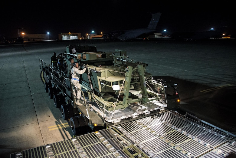 Airmen assigned to the 60th Aerial Port Squadron push a  U.S. Army Bridge Erection Boat (BEB) off a Tunner 60K loader onto a C-5M Super Galaxy May 7, 2016, at Travis Air Force Base, Calif. The 60th APS successfully uploaded multiple BEBs and bridges onto the aircraft where they were transported to Iraq in support of Operation Inherent Resolve. (U.S. Air Force by Staff Sgt. Charles Rivezzo)