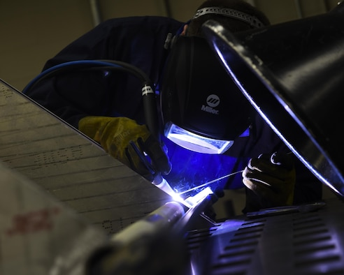 U.S. Air Force Tech. Sgt. Trevor Sutton, 53rd Test Support Squadron Special Devices Flight fabrication section chief, welds a stainless steel section of a custom design at Tyndall Air Force Base, Fla., Nov. 2, 2016. Metals technology technicians like Sutton are experts at welding, fabricating and custom design requests. (U.S. Air Force photo by Airman 1st Class Cody R. Miller/Released)