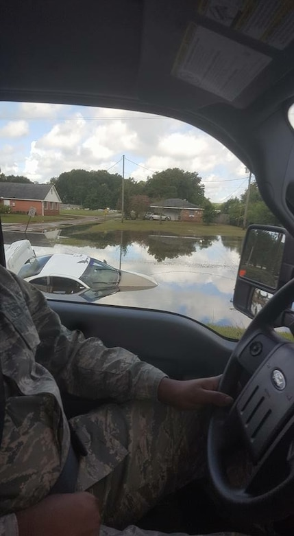 A week after the storm, an Airman with the Mobile Emergency Operations Center passes a submerged car in East Baton Rouge Parish while en route to a new mission assignment. (U.S. Air Force photo/Master Sgt. Tasha B. Sheets)