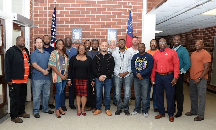Marine Corps Logistics Base Albany's veterans unite to commemorate the 2016 Veterans Day holiday and to honor the service and sacrifice of fellow comrades. All U.S. branches of service were represented in Communications and Information Systems Division's team of veterans.