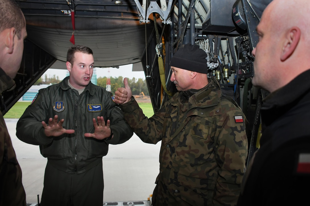 Staff Sgt. Matt Massey, 700th Airlift Squadron loadmaster, discusses a flight mission plan with Polish air force paratroopers at Krakow Airport, Poland on Oct. 13, 2016. The 94th Airlift Wing, from Dobbins Air Reserve Base, Ga., and the 86th Airlift Wing, from Ramstein Air Base, Germany, trained jointly with the Polish air force during Aviation Detachment 17-1 in support of Operation Atlantic Resolve, Oct. 3-28. (U.S. Air Force photo by Staff Sgt. Alan Abernethy)