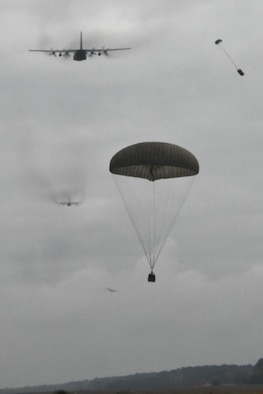 Airdropped cargo falls from a U.S. C-130H Hercules during a five-ship formation flight including U.S. and Polish air force aircraft, Oct. 26, 2016. The flight was a capstone event for Aviation Detachment 17-1, supporting Operation Atlantic Resolve, held at Powidz Air Base, Poland, Oct. 3-28. (U.S. Air Force photo by Staff Sgt. Alan Abernethy)