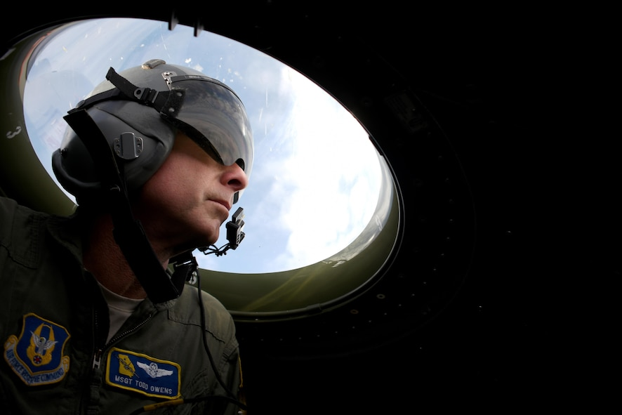 Master Sgt. Todd Owens, 700th Airlift Squadron loadmaster, keeps watch for a Polish F-16 during a fighter evasion training flight over Poland, Oct. 25, 2016. The 94th Airlift Wing trained jointly with the Polish air force during Aviation Detachment 17-1 in support of Operation Atlantic Resolve, Oct. 3-28. (U.S. Air Force photo by Staff Sgt. Alan Abernethy)