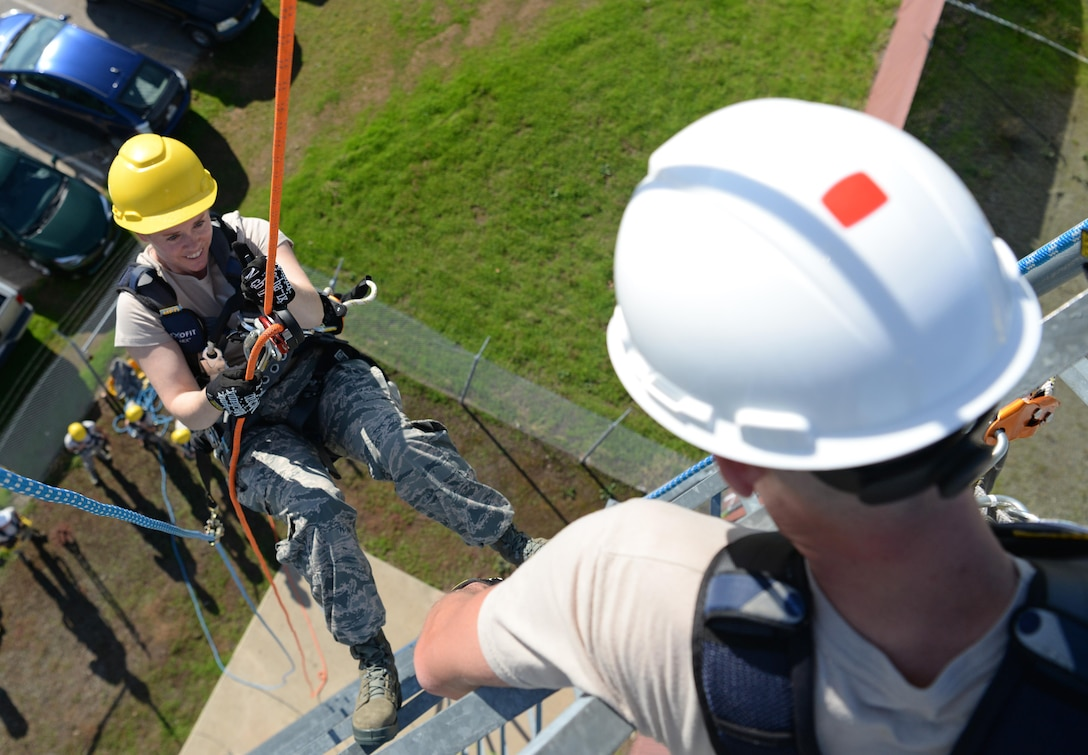 Staff Sgt. Ryan Stichberry, 9th Communication Squadron cable and antenna maintainer, instructs Chief Master Sgt. Jessica Bender, 9th Reconnaissance Wing command chief, how to rappel down a tower Nov. 8, 2016, at Beale Air Force Base, California. Bender was immersed in the climbing training to better understand the requirements an Airman must meet to be certified to climb. (U.S. Air Force photo/Airman Tristan D. Viglianco)