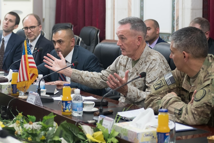 Marine Corps Gen. Joe Dunford, chairman of the Joint Chiefs of Staff, makes a point during a meeting with Iraqi Chief of Staff Army Gen. Othman al-Ghanami at Iraq's Defense Ministry in Baghdad, Nov. 9, 2016. DoD Photo by D. Myles Cullen